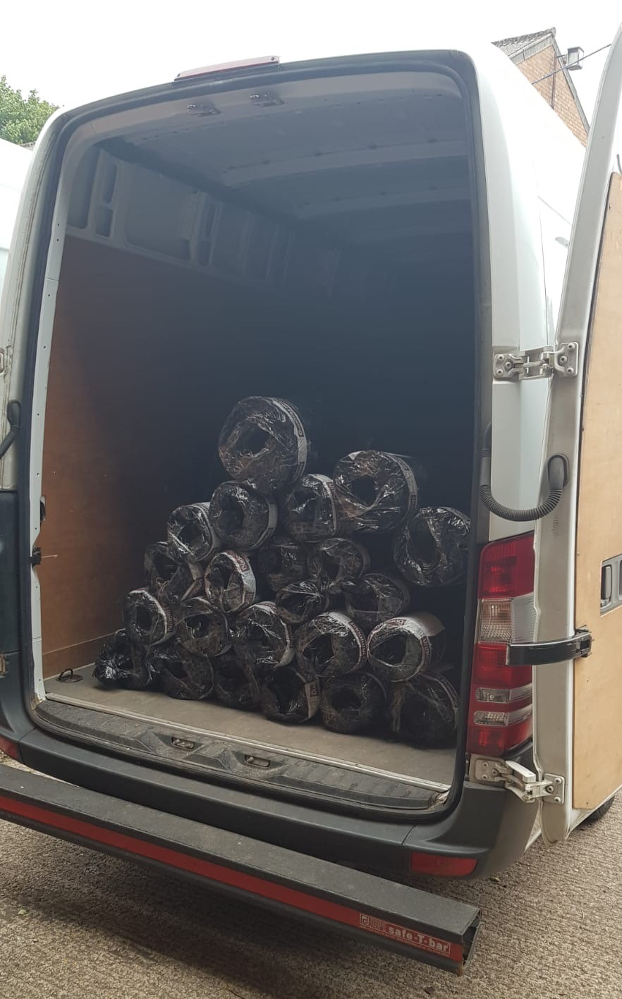 example of van filled with rugs for delivery